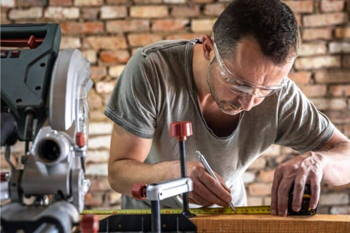 carpenter working with a miter saw